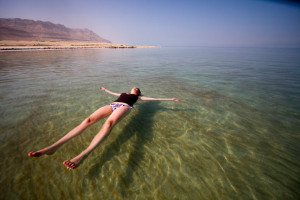 The dense salty water of the Dead Sea makes it very easy to float - without a floaty!