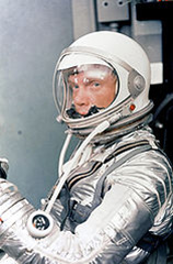 Astronaut John H. Glenn Jr. dons his silver Mercury pressure suit in preparation for launch of Mercury Atlas 6 (MA-6) rocket. Source:NASA